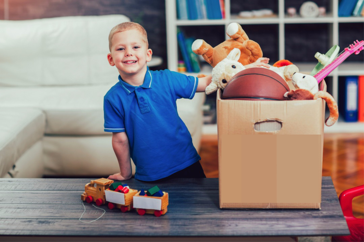 boy picking up toys. Kitchen clutter solutons