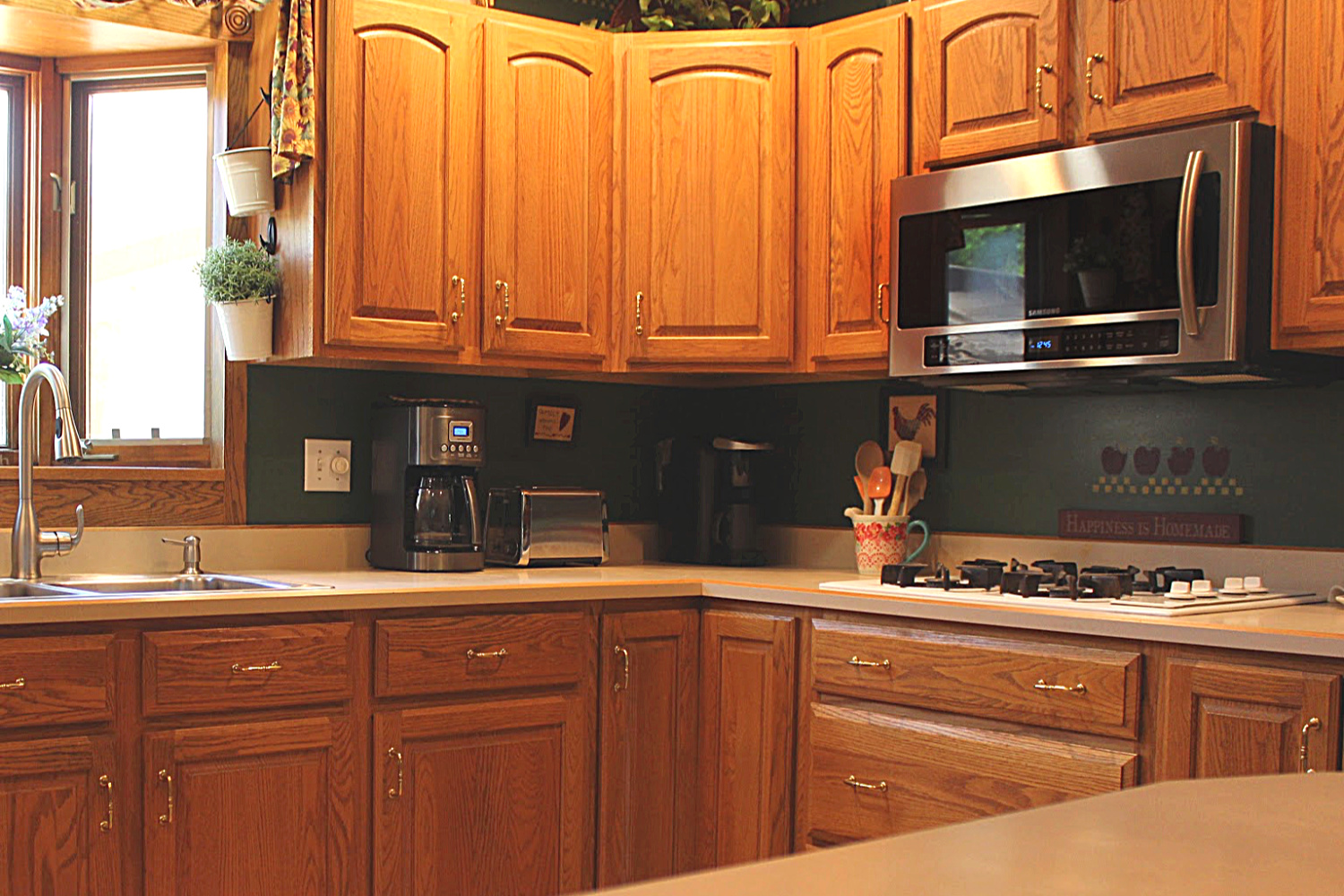 a kitchen with a microwave. Microwave cleaning hacks you can try today