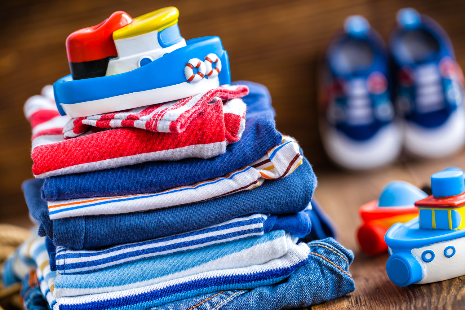 A pile of outgrown baby clothes that can be given away. How to start decluttering when it's hard