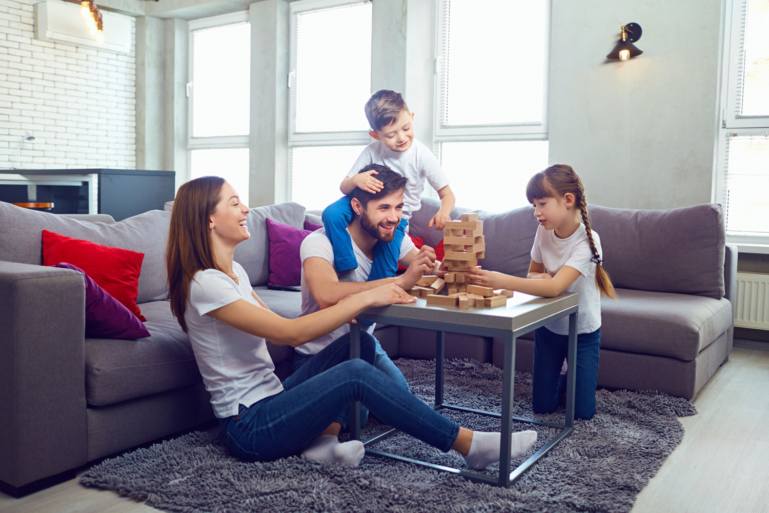 family playing a game. Easy decluttering tips for a clutter free home.