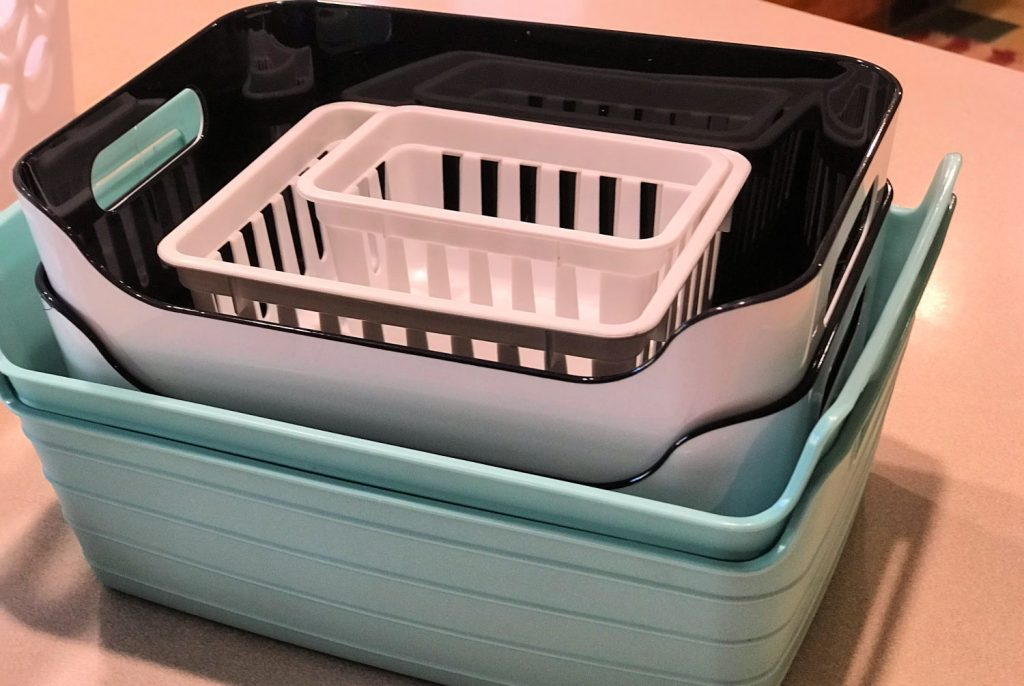 small organizing bins found in a decluttering kit