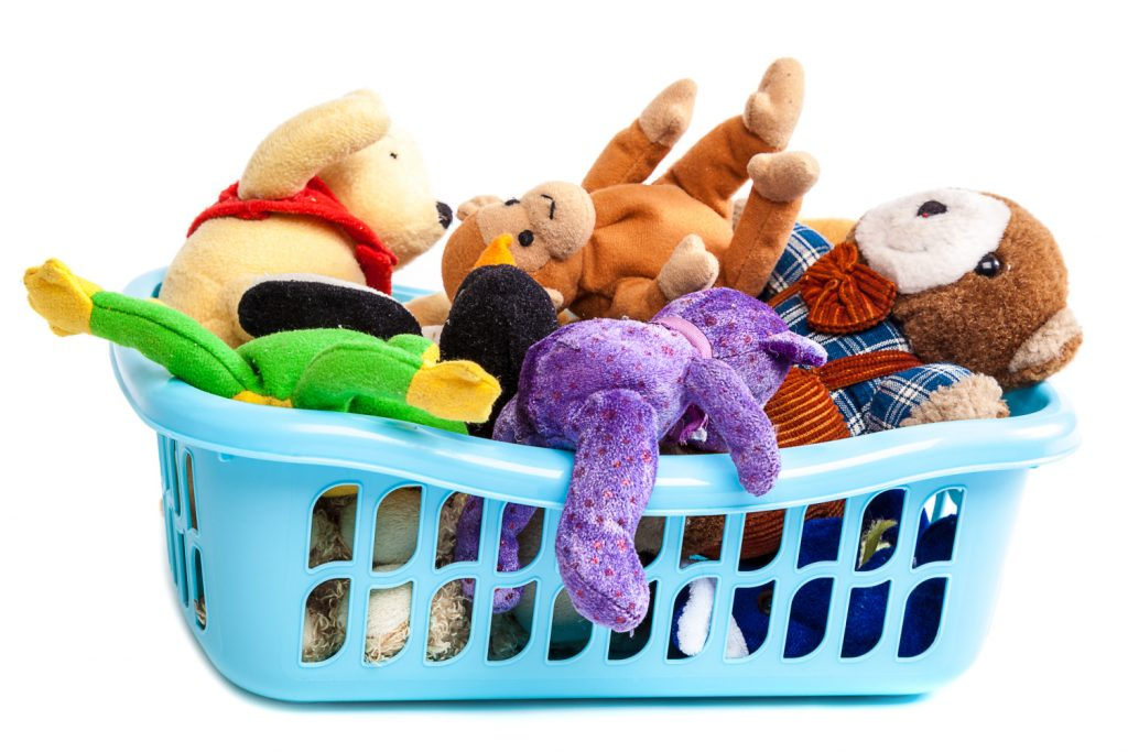 a basket full of toys. Easy decluttering tips you can do today.