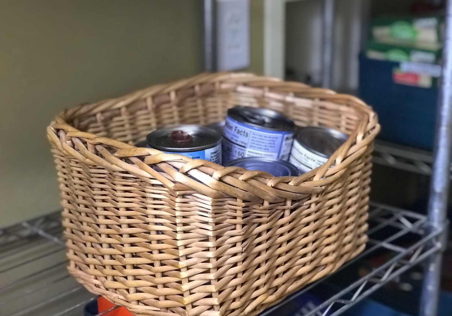 baskets with soup cans on a pantry shelf
