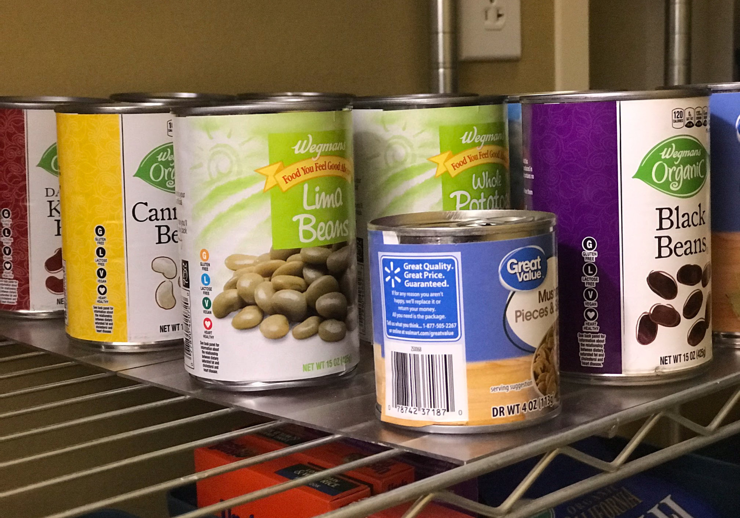 cans on plexiglass in a pantry