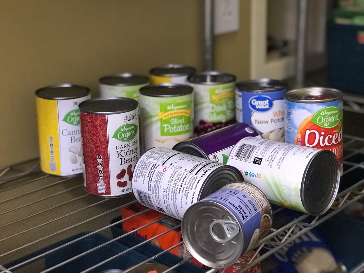 falled cans in a messy pantry