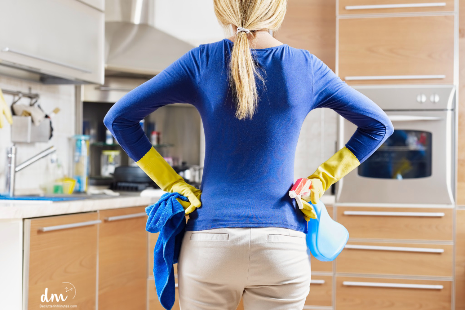 women getting ready to clean with her new decluttering plan