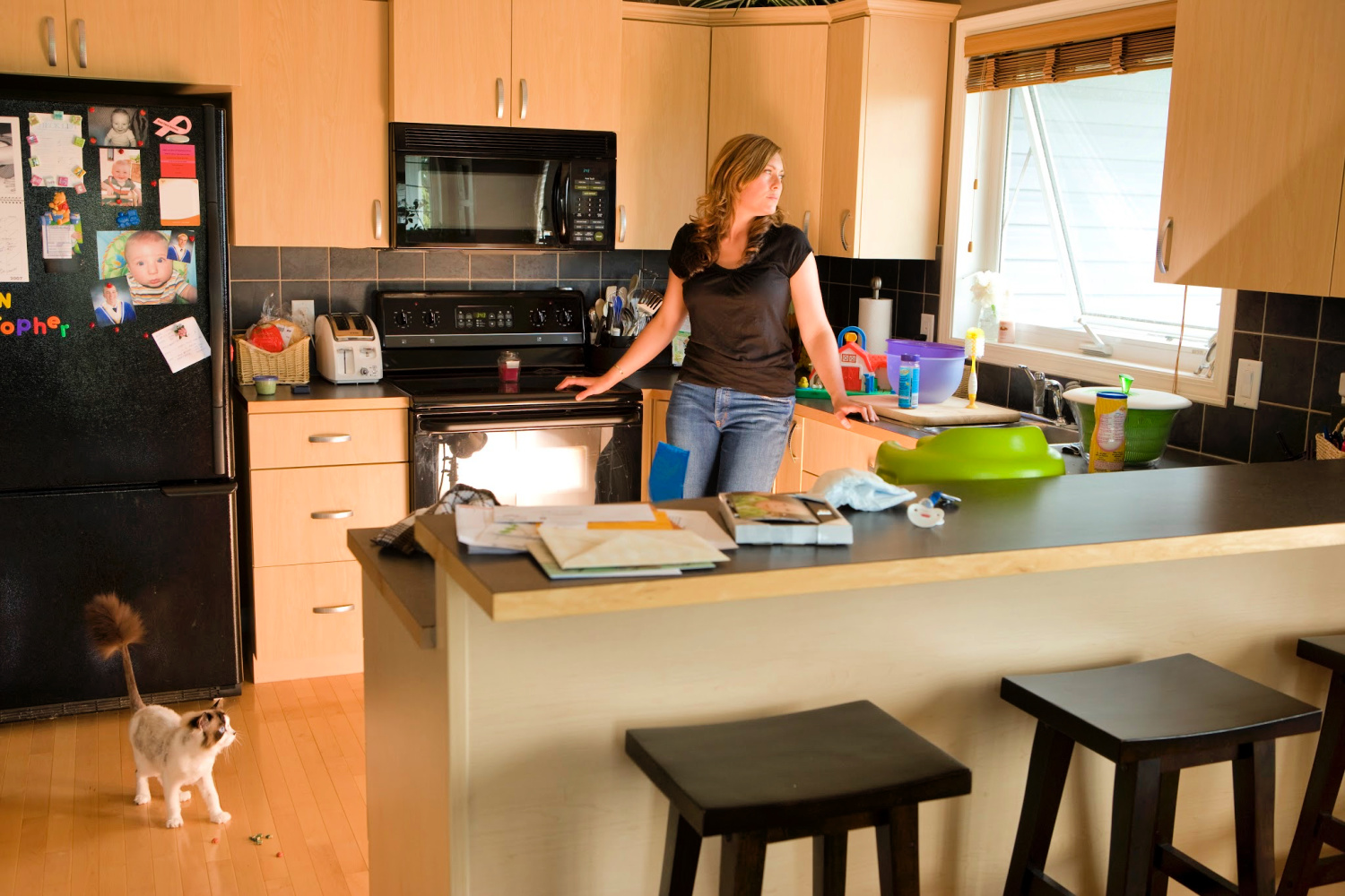 woman in a messy kitchen. Home decluttering hacks