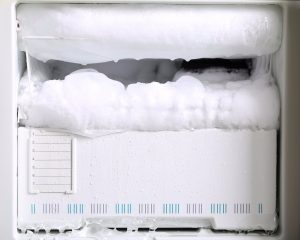 a freezer full of frost. How to clean out a freezer to help it last longer.