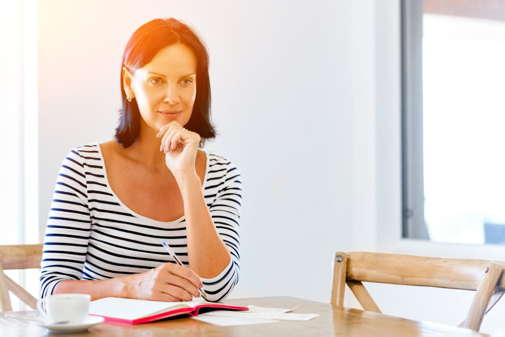 woman creating an actionable to do list