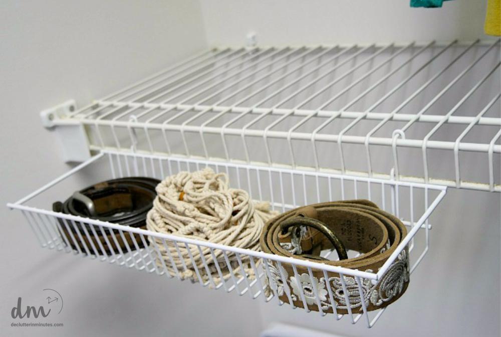 belts in a closet basket