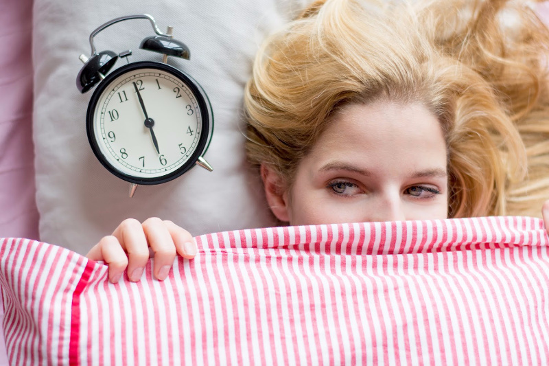 woman waking up happy with a morning routine