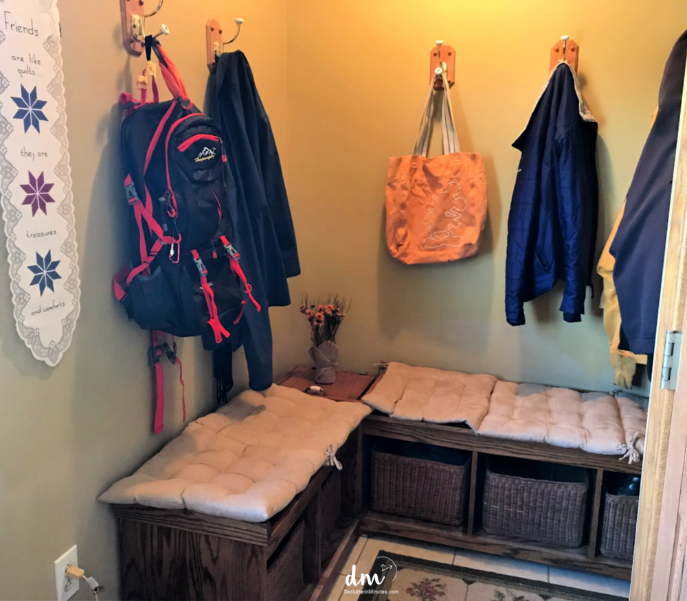 mudroom organized with baskets