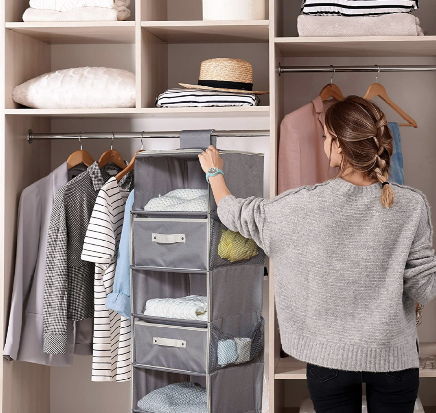 woman using best closet organizers