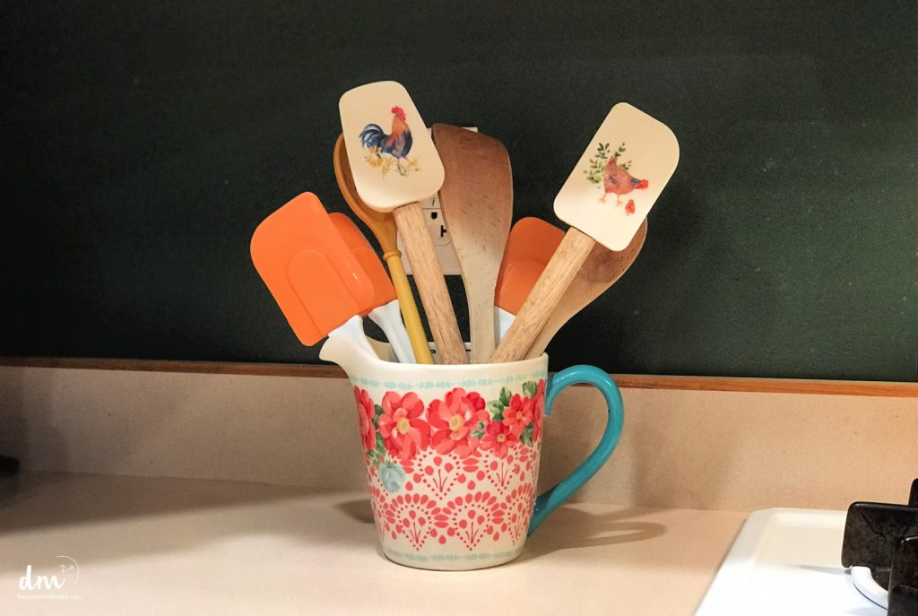 Spatulas in a crock on a kitchen counter