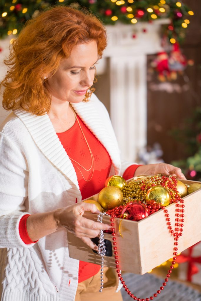 woman holding a box of holiday decorations