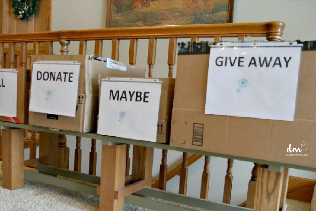 boxes labeled donate, maybe, give away