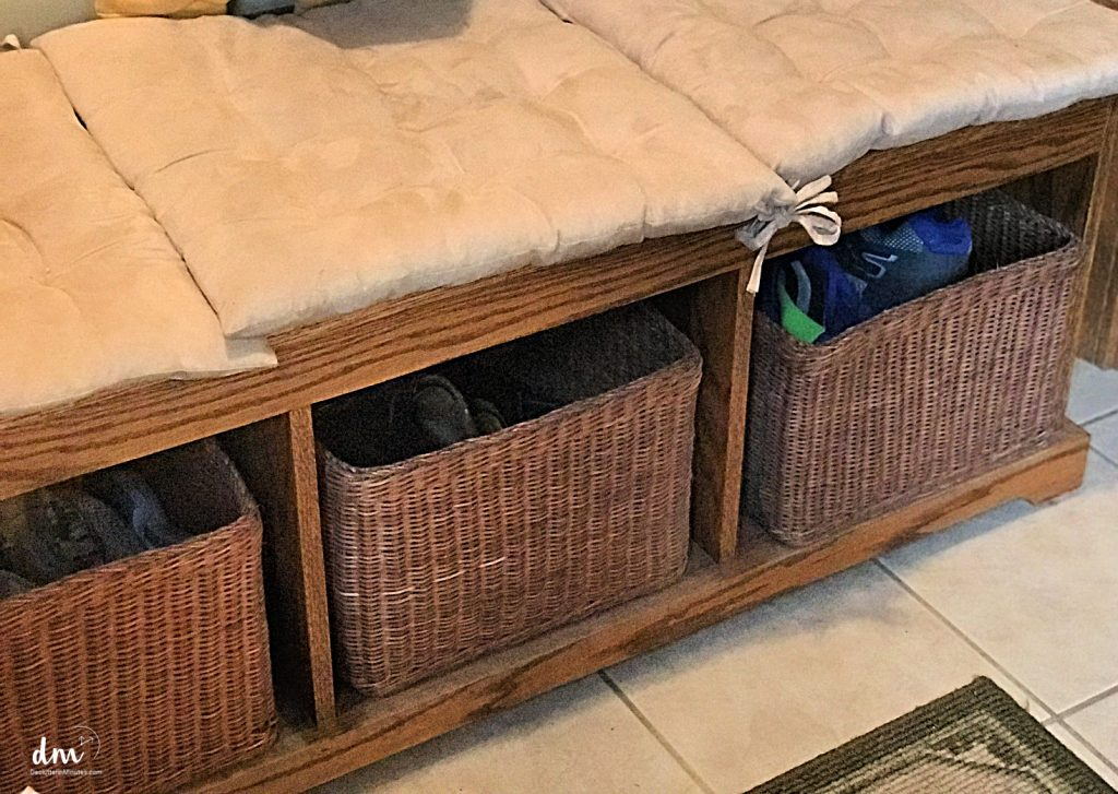 shoe baskets under a bench in mudroom