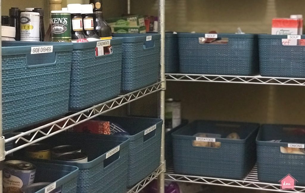 blue labeled bins in a food pantry