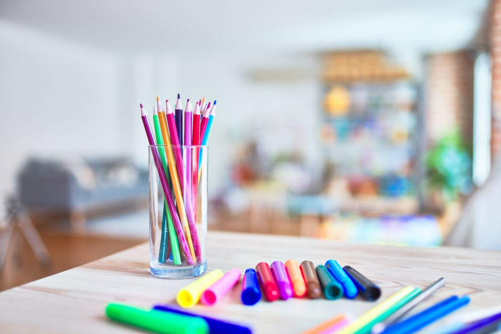 table of pens and markers in a craft room