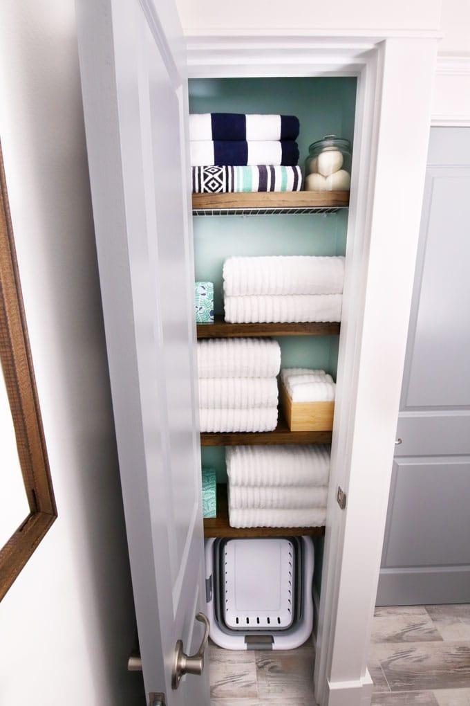 organize narrow linen closet